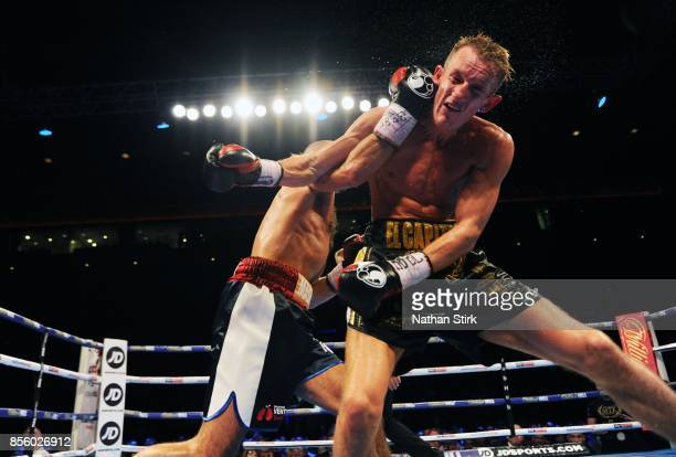 Tom Stalker is punched by Sean Dodd during the Battle on the Mersey Commonwealth Lightweight Championship fight at Echo Arena on September 30 2017 in...