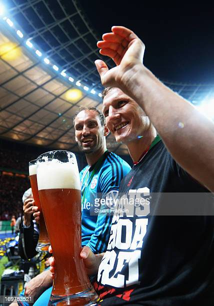Tom Starke and Bastian Schweinsteiger of Bayern Muenchen celebrate victory after the DFB Cup Final match between FC Bayern Muenchen and VfB Stuttgart...