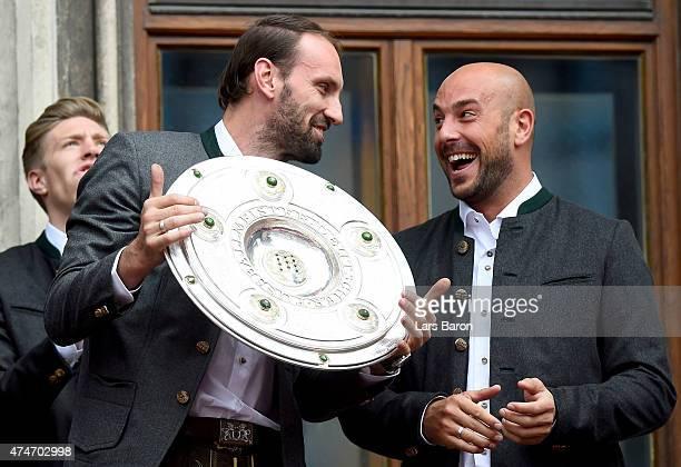 Tom Starke and Pepe Reina celebrate winning the Bundesliga at Marienplatz on May 24 2015 in Munich Germany
