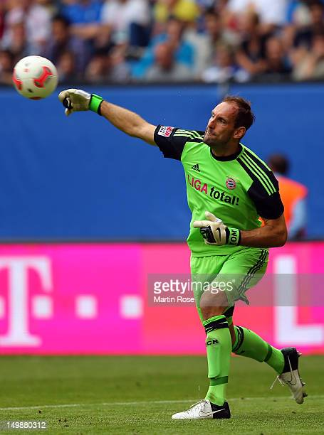 Tom Starke goalkeeper of Bayern Muenchen throws the ball during the LIGA total Cup 3rd place match between Hamburger SV and Bayern Muenchen at Imtech...
