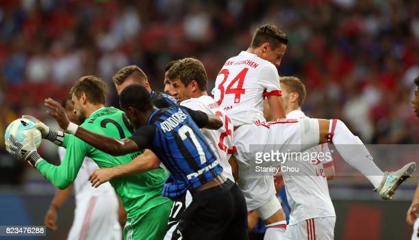 Tom Starke of FC Bayern saves the ball in a goalmouth scarmble during the International Champions Cup match between FC Bayern and FC Internazionale...