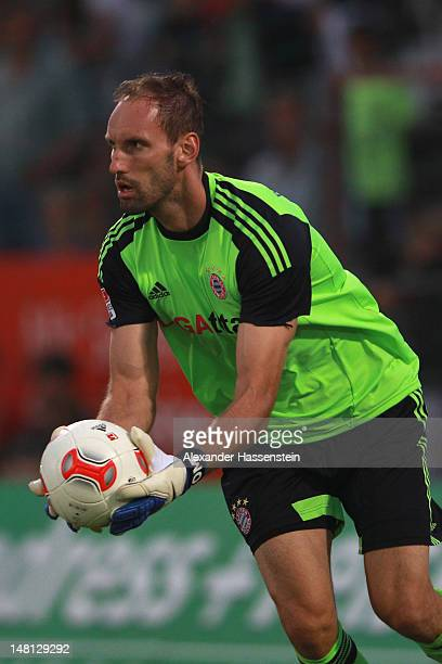 Tom Starke of Muenchen safes the ball during the friendly match between SpVgg Unterhaching and FC Bayern Muenchen at Sportpark Unterhaching on July...