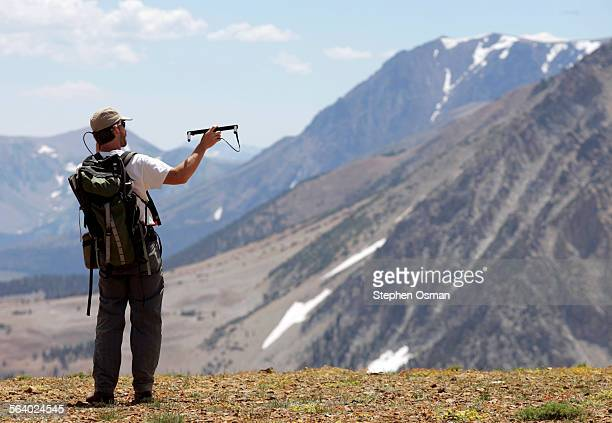 Tom Stephenson a biologist with the California Department of Fish and Game working on the Sierra Nevada Bighorn Sheep Recovery Program uses a VHF...