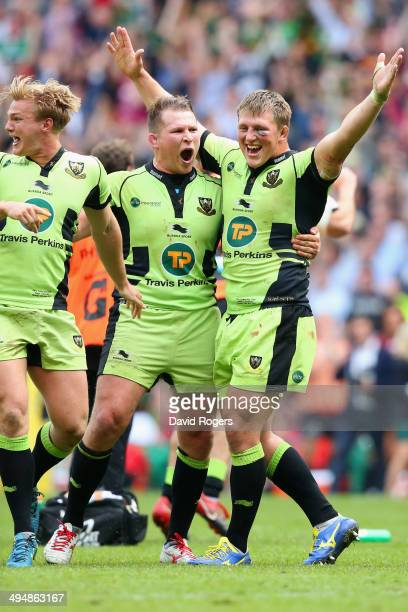 Tom Stephenson Alex Waller and Dylan Hartley of Northampton Saints celebrate victory during the Aviva Premiership Final between Saracens and...