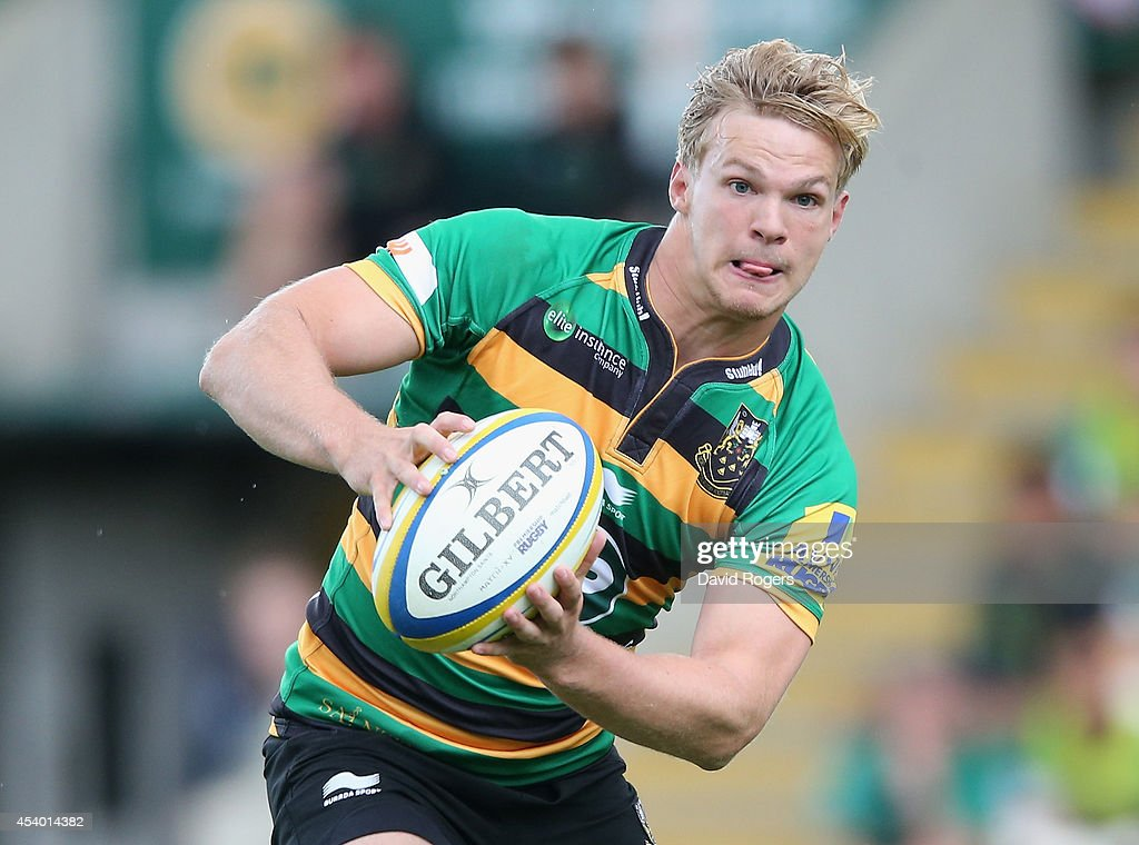 Tom Stephenson of Northampton runs with the ball during the pre season friendly match between Northampton Saints and Leinster at Franklin's Gardens on August 23, 2014 in Northampton, England.