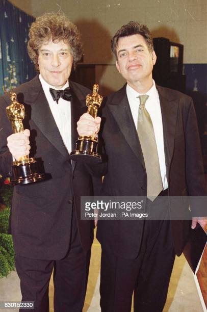 Tom Stoppard and cowriter Marc Norman with their Oscars for Best Original Screenplay which they won at the 71st annual Academy Awards for the film...