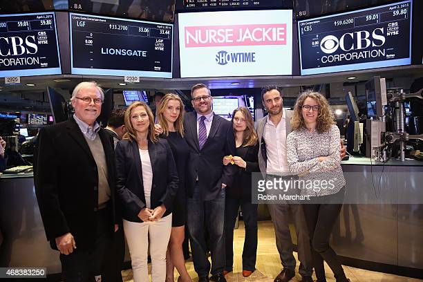 Tom Straw Edie Falco Betty Gilpin Stephen Wallem Merritt Wever Dominic Fumusa and Liz Flahive of 'Nurse Jackie' Rings The New York Stock Exchange...