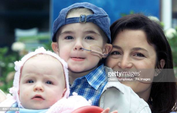 Tom Stretch three hugs his ten monthold sister Hannah and mother Joanne who both helped cure him of a potentially fatal disease in Newcastle * Tom...