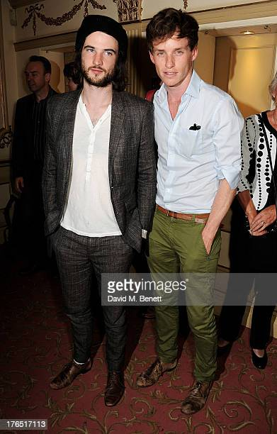 Tom Sturridge and Eddie Redmayne pose in the foyer following the press night performance of 'A Doll's House' at the Duke Of Yorks Theatre on August...