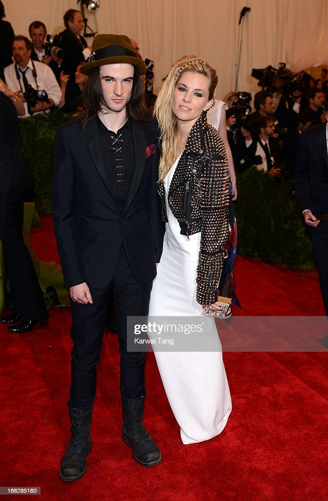 Tom Sturridge and Sienna Miller attends the Costume Institute Gala for the 'PUNK: Chaos to Couture' exhibition at the Metropolitan Museum of Art on May 6, 2013 in New York City.