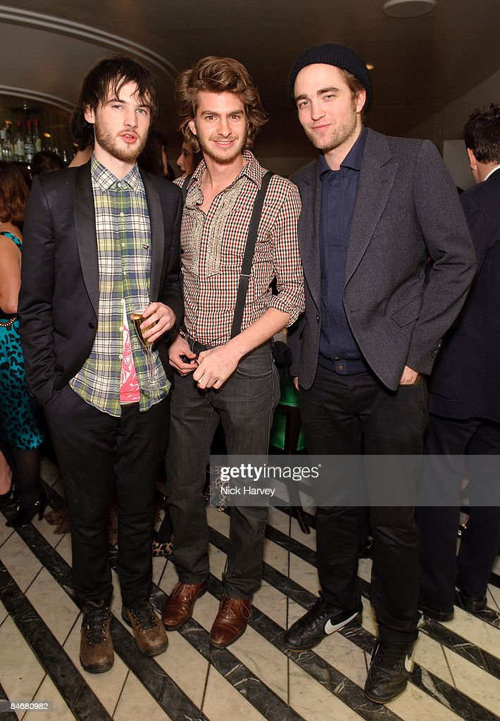 Tom Sturridge, <a gi-track='captionPersonalityLinkClicked' href=/galleries/search?phrase=Andrew+Garfield&family=editorial&specificpeople=4047840 ng-click='$event.stopPropagation()'>Andrew Garfield</a> and Robert Pattison attend Vogue's dinner hosted by Alexandra Shulman and Nick Jones at Cecconi's on February 6, 2009 in London.