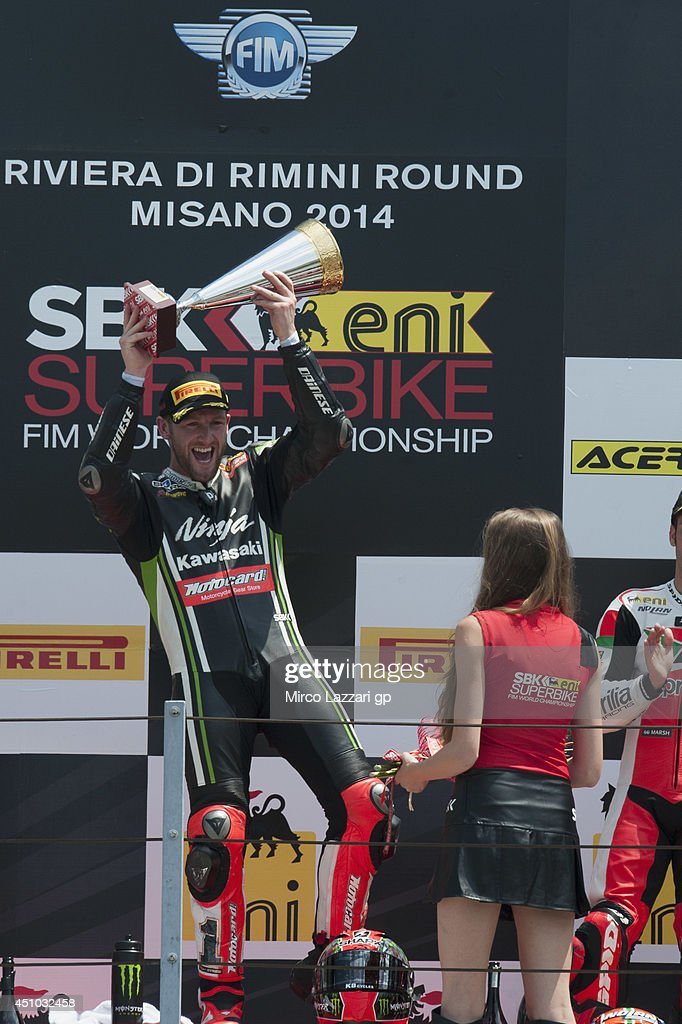 <a gi-track='captionPersonalityLinkClicked' href=/galleries/search?phrase=Tom+Sykes&family=editorial&specificpeople=3070262 ng-click='$event.stopPropagation()'>Tom Sykes</a> of Great Britain and Kawasaki Racing Team celebrates the victory on the podium at the end of the Superbike race 2 during the FIM Superbike World Championship - Race at Misano World Circuit on June 22, 2014 in Misano Adriatico, Italy.