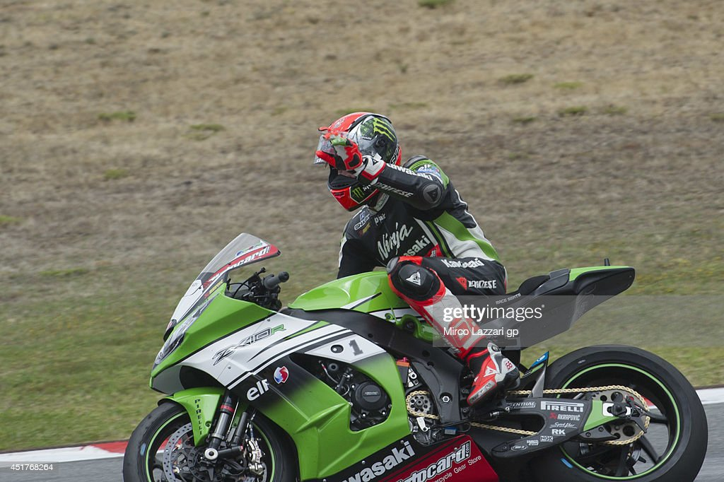 <a gi-track='captionPersonalityLinkClicked' href=/galleries/search?phrase=Tom+Sykes&family=editorial&specificpeople=3070262 ng-click='$event.stopPropagation()'>Tom Sykes</a> of Great Britain and Kawasaki Racing Team celebrates the victory at the end of the race 1 during the FIM Superbike World Championship - Race at Portimao Circuit on July 6, 2014 in Portimao, Portugal.