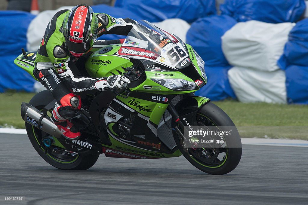 Tom Sykes of Great Britain and Kawasaki Racing Team heads down a straight during the World Superbikes - Qualifying during the round five of 2013 Superbikes FIM World Championship at Donington Park on May 25, 2013 in Castle Donington, England.
