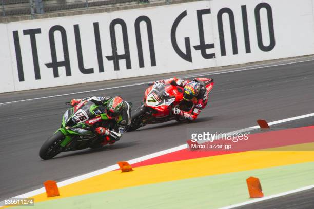 Tom Sykes of Great Britain and Kawasaki Racing Team leads Chaz Davies of Great Britain and ARUBAIT RACINGDUCATI during the Superbike race 1 during...