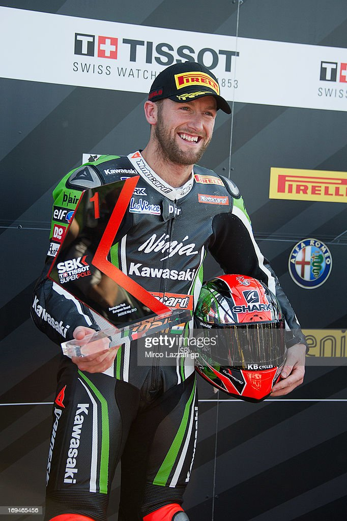 Tom Sykes of Great Britain and Kawasaki Racing Team poses and celebrates the Super Pole during the World Superbikes - Qualifying during the round five of 2013 Superbikes FIM World Championship at Donington Park on May 25, 2013 in Castle Donington, England.