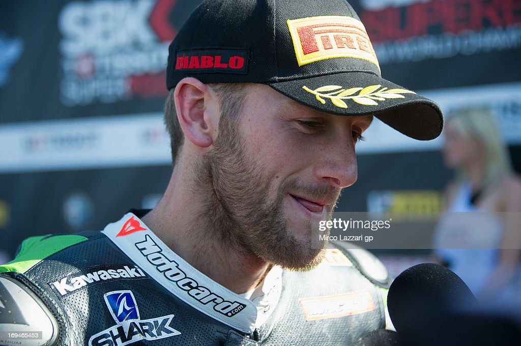 Tom Sykes of Great Britain and Kawasaki Racing Team speaks with journalists at the end of the Super Pole during the World Superbikes - Qualifying during the round five of 2013 Superbikes FIM World Championship at Donington Park on May 25, 2013 in Castle Donington, England.