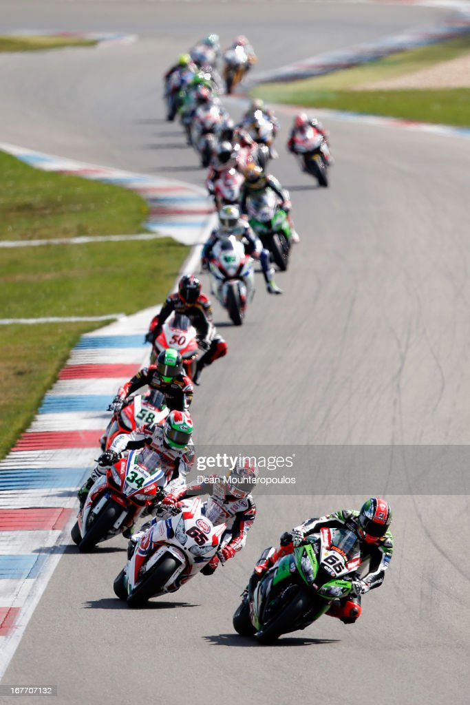 Tom Sykes (#66) of Great Britain on the Kawasaki ZX-10R for Kawasaki Racing Team and <a gi-track='captionPersonalityLinkClicked' href=/galleries/search?phrase=Jonathan+Rea&family=editorial&specificpeople=2643129 ng-click='$event.stopPropagation()'>Jonathan Rea</a> (#65) of Great Britain on the Honda CBR1000RR for Pata Honda World Superbike lead the pack in the World Superbikes Race 1 at TT Circuit Assen on April 28, 2013 in Assen, Netherlands.