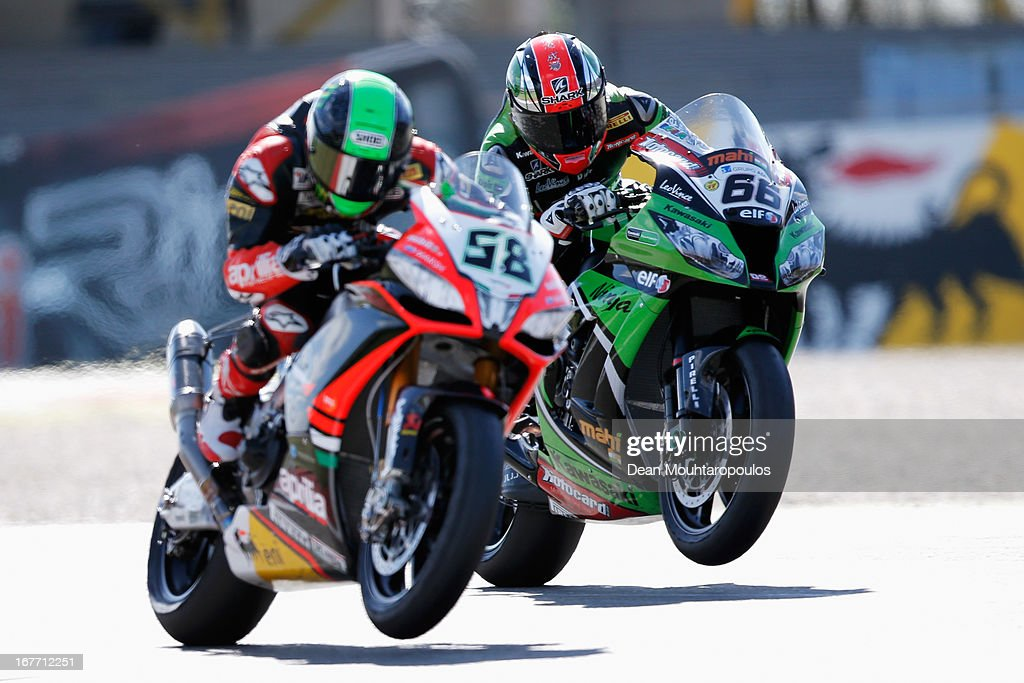 Tom Sykes (#66) of Great Britain on the Kawasaki ZX-10R for Kawasaki Racing Team and <a gi-track='captionPersonalityLinkClicked' href=/galleries/search?phrase=Eugene+Laverty&family=editorial&specificpeople=4253466 ng-click='$event.stopPropagation()'>Eugene Laverty</a> (#58) of Ireland on the Aprilia RSV4 for the Aprilia Racing Team battle for position during the World Superbikes Race 2 at TT Circuit Assen on April 28, 2013 in Assen, Netherlands.