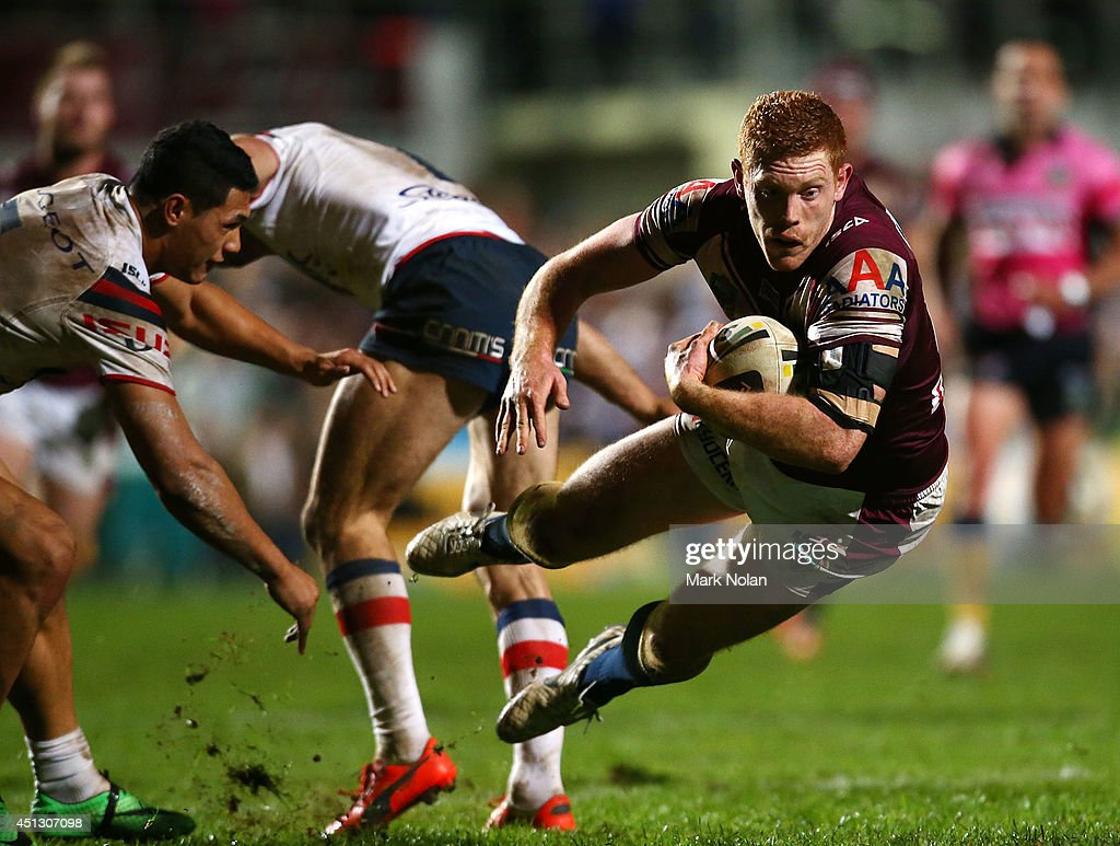 Tom Symonds of the Eagles bounces out of a tackle during the round 16 NRL match between the Manly Sea Eagles and the Sydney Roosters at Brookvale Oval on June 27, 2014 in Sydney, Australia.