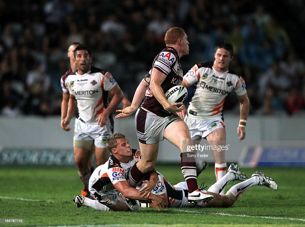 Tom Symonds of the Sea Eagles steps through the Wests Tigers defence during the round four NRL match between the Manly Sea Eagles and the Wests Tigers at Bluetongue Stadium on March 28, 2013 in Gosford, Australia.