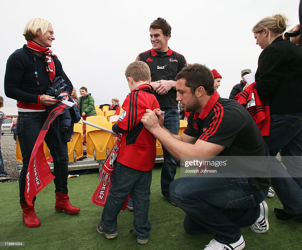 Tom Taylor and Matt Todd of the Crusaders sign autographs after a media announcement that BNZ will be naming rights sponsor of the Crusaders on July 19, 2013 in Christchurch, New Zealand.