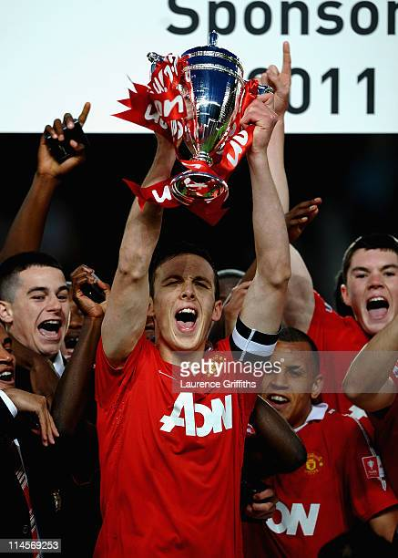Tom Thorpe of Manchester United lifts the Trophy in celebration during the FA Youth Cup Final 2nd Leg match between Manchester United and Sheffield...