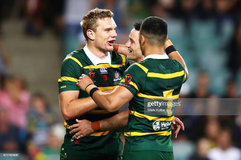 Tom Trbojevic of Australia celebrates with his team mates Cooper Cronk and Valentine Holmes of Australia after scoring a try during the 2017 Rugby League World Cup match between Australia and Lebanon at Allianz Stadium on November 11, 2017 in Sydney, Australia.