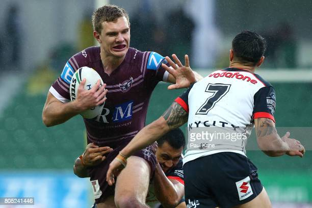Tom Trbojevic of the Sea Eagles fends off atackle by Shaun Johnson of the Warriors during the round 17 NRL match between the Manly Sea Eagles and the...