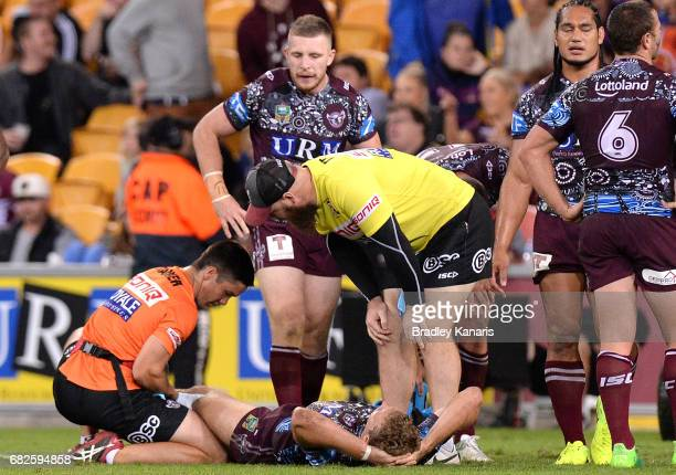 Tom Trbojevic of the Sea Eagles is injured during the round 10 NRL match between the Manly Sea Eagles and the Brisbane Broncos at Suncorp Stadium on...