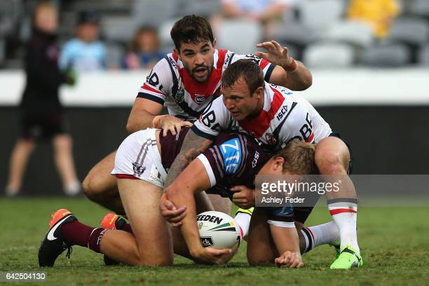 Tom Trbojevic of the Sea Eagles is tackled by Jake Friend of the Roosters during the NRL Trial match between the Manly Warringah Sea Eagles and...