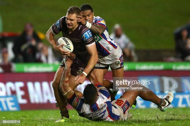 Tom Trbojevic of the Sea Eagles is tackled during the round 14 NRL match between the Manly Sea Eagles and the Newcastle Knights at Lottoland on June...