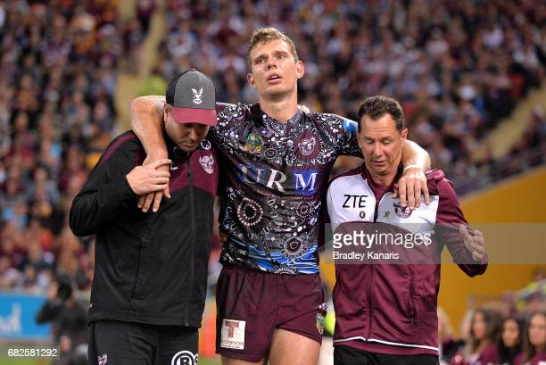 Tom Trbojevic of the Sea Eagles is taken from the field injured during the round 10 NRL match between the Manly Sea Eagles and the Brisbane Broncos...