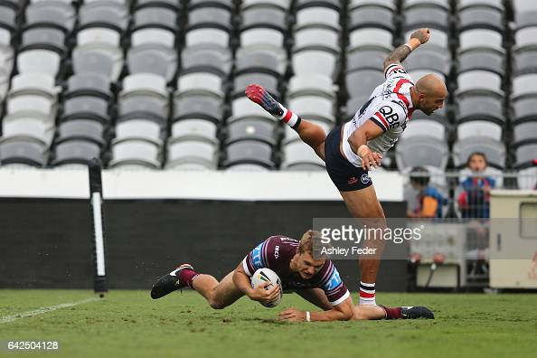 Tom Trbojevic of the Sea Eagles scores a try with Blake Ferguson of the Roosters in defence during the NRL Trial match between the Manly Warringah...