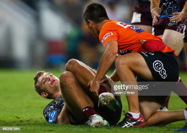 Tom Trbojevic of the Sea Eagles suffers an injury during the round 10 NRL match between the Manly Sea Eagles and the Brisbane Broncos at Suncorp...