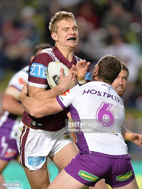 Tom Trbojevic of the Sea Eagles takes on the defence during the round 24 NRL match between the Manly Sea Eagles and the Melbourne Storm at Brookvale...