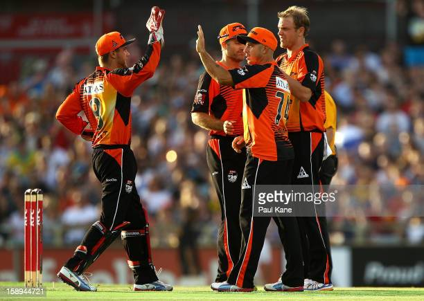 Tom Triffitt Herschelle Gibbs and Michael Beer of the Scorchers celebrate dismissing Simon Keen of the Thunder during the Big Bash League match...