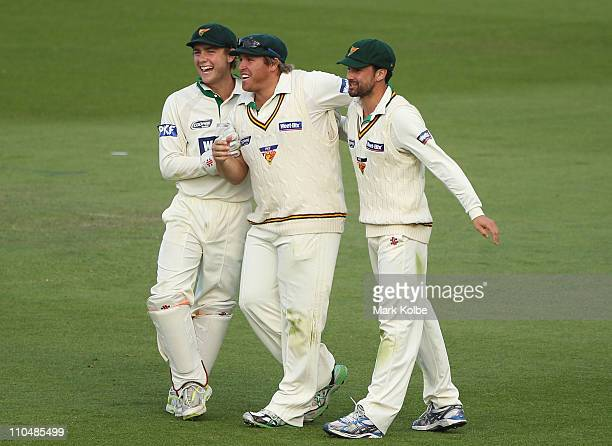 Tom Triffitt Mark Cosgrove and Ed Cowan of the Tiger celebrate after running out Simon Katich of the Blues during day four of the Sheffield Shield...