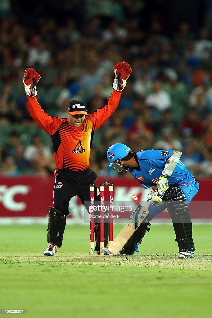 Tom Triffitt of Perth celebrates as Nathan Lyon of Adelaide is bowled out during the Big Bash League match between the Adelaide Strikers and the Perth Scorchers at Adelaide Oval on January 10, 2013 in Adelaide, Australia.