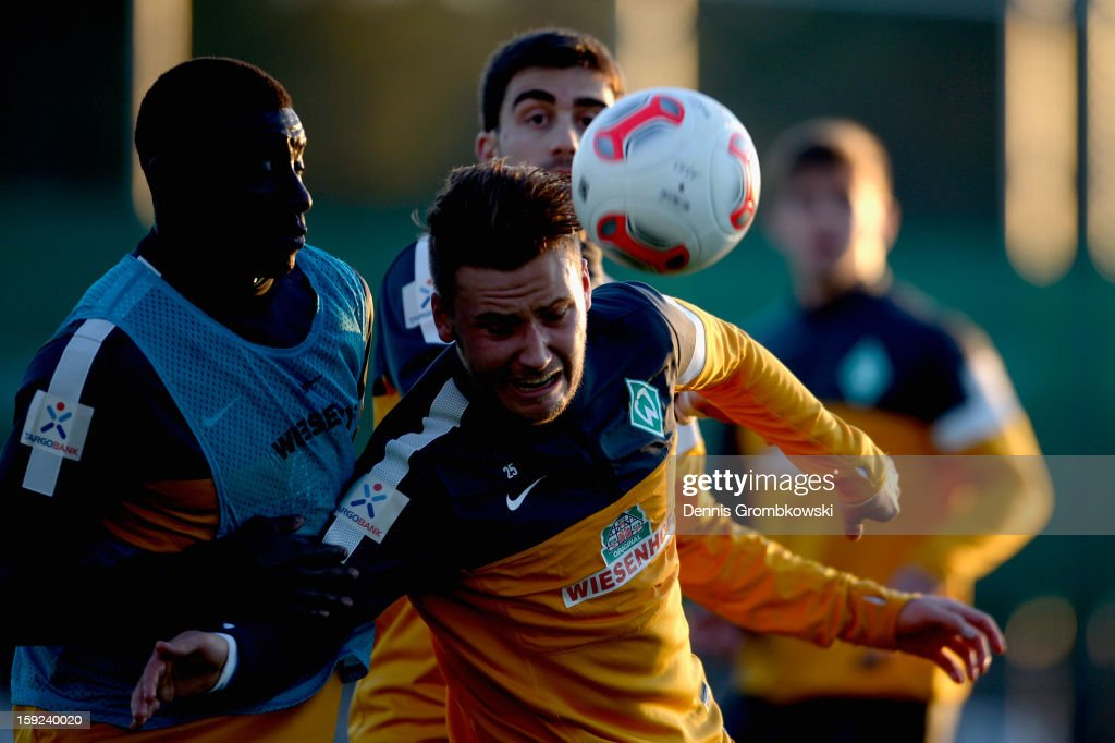 Tom Trybull of Bremen and teammate Joseph Akpala battle for the ball during a training session at day six of the Werder Bremen Training Camp on January 10, 2013 in Belek, Turkey.