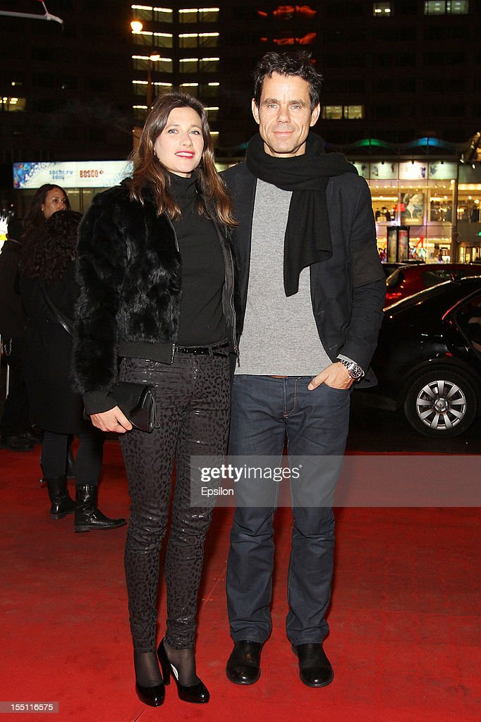 Tom Tykwer (R) and wife attend the premiere of Warner Bros. Pictures' 'Cloud Atlas' in Oktyabr cinema hall on November 1, 2012 in Moscow, Russia.