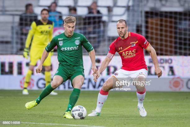 Tom van Weert of FC Groningen Ron Vlaar of AZduring the Dutch Eredivisie playoffs match AZ Alkmaar and FC Groningen at AFAS stadium on May 20 2017 in...
