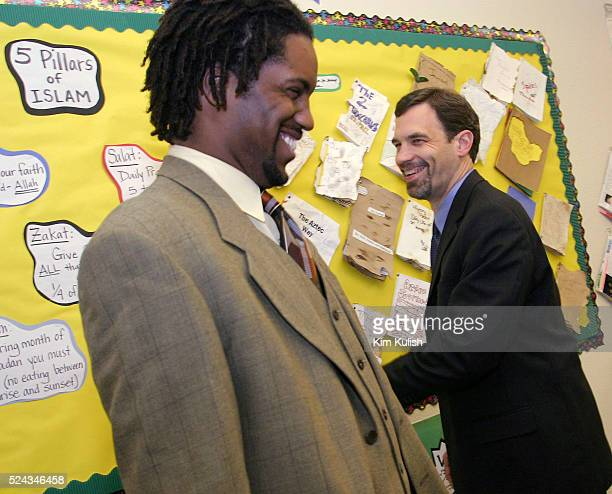 Tom Vander Ark Executive Director Education for the Bill and Melinda Gates Foundation laughs with Principal Troyvoi Hicks during his visit to the...