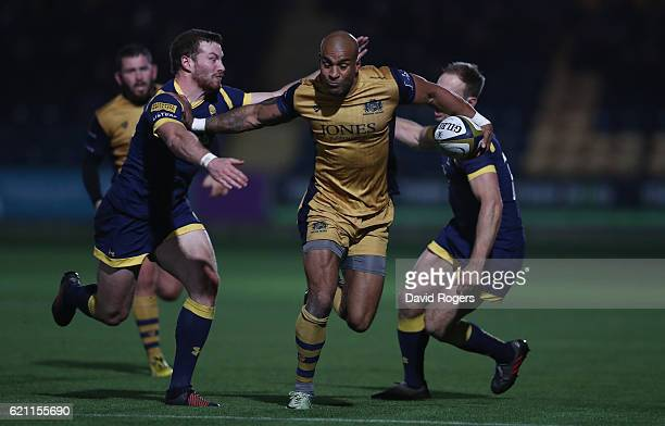 Tom Varndell of Bristol moves past Chris Pennell and Max Stelling during the AngloWelsh Cup match between Worcester Warriors and Bristol at Sixways...
