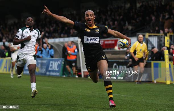 Tom Varndell of London Wasps celebrates running in a try during the Aviva Premiership match between London Wasps and London Irish at Adams Park on...