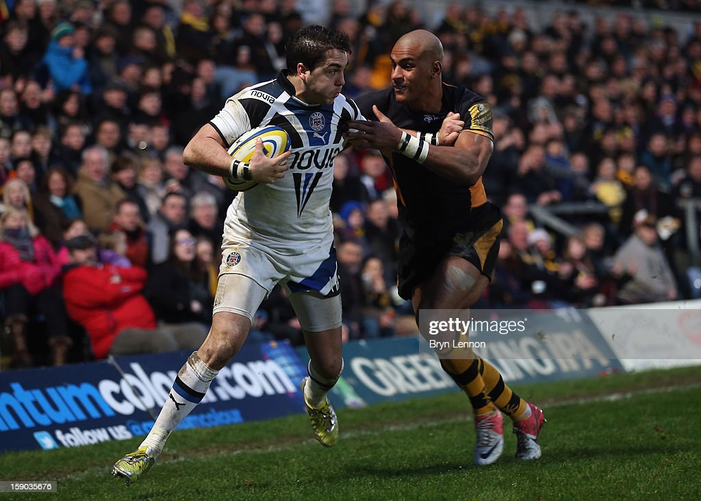 <a gi-track='captionPersonalityLinkClicked' href=/galleries/search?phrase=Tom+Varndell&family=editorial&specificpeople=561563 ng-click='$event.stopPropagation()'>Tom Varndell</a> of London Wasps tackles Horacio Agulla of Bath during the Aviva Premiership match between London Wasps and Bath at Adams Park on January 6, 2013 in High Wycombe, England.