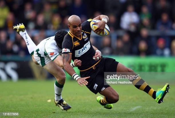 Tom Varndell of Wasps is tackled by Jon Clarke of Saints during the Aviva Premiership match between London Wasps and Northampton Saints at Adams Park...