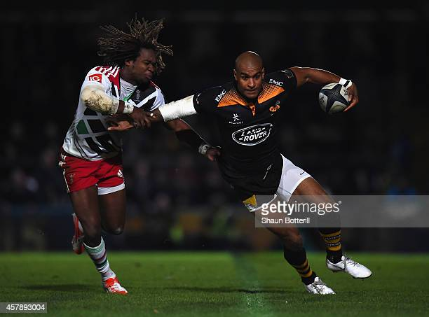 Tom Varndell of Wasps is tackled by Marland Yarde of Harlequins during the European Rugby Champions Cup match between Wasps and Harlequins at Adams...