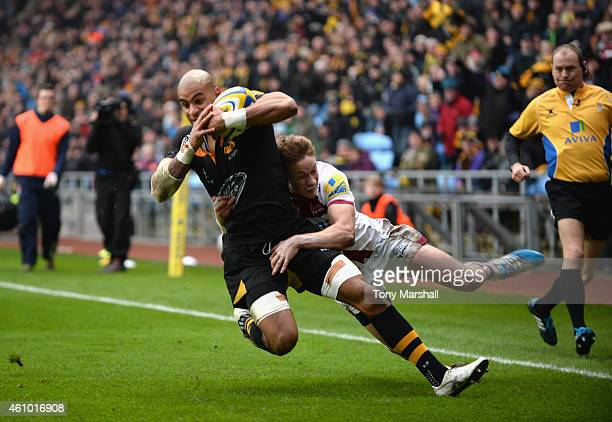 Tom Varndell of Wasps is tackled by Michael Haley of Sale Sharks during the Aviva Premiership match between Wasps and Sale Sharks at The Ricoh Arena...