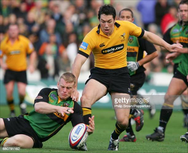 Tom Voyce of London Wasps and Darren Fox of Northampton Saints in action during the Zurich Premiership match between London Wasps and Northampton...